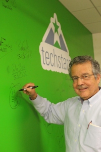 Mentor and Limited Partner Joe Caruso signs in.